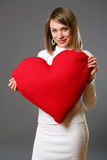 Portrait of beautiful woman with red heart Royalty Free Stock Photo
