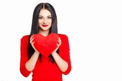 Portrait of a beautiful woman with red heart in hands. Stock Images