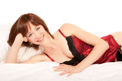 Portrait of a beautiful woman in red lingerie Stock Images