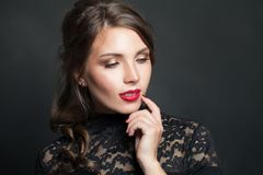 Portrait of beautiful woman with red lips makeup hair on dark background royalty free stock images