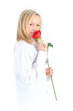 Portrait of a beautiful woman with a red rose. Royalty Free Stock Image