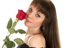 Portrait of a beautiful woman with a red rose Stock Photo