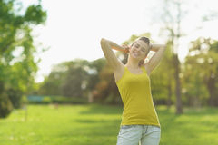 Portrait of beautiful woman relaxing in park|flare Royalty Free Stock Photos