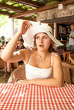 Portrait of beautiful woman in restaurant looking with amazement Stock Image