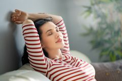Woman resting on sofa stock photography