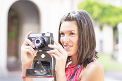 Portrait of beautiful woman with retro camera. Royalty Free Stock Photo