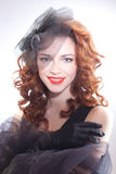 Portrait of beautiful woman in retro style in black dress Royalty Free Stock Image
