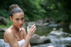 Portrait of beautiful woman in river. Portrait of beautiful young woman driniking water in a river Stock Images