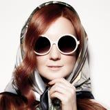 Portrait of beautiful woman in round fashion sunglasses. Stock Image