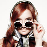 Portrait of beautiful woman in round fashion sunglasses. Stock Photography