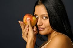 Portrait of the beautiful woman's keeping the raw. Apple Royalty Free Stock Photo