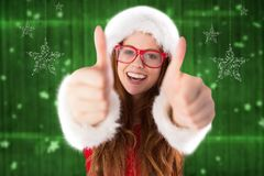 Portrait of beautiful woman in santa costume giving thumbs up sign Royalty Free Stock Photo