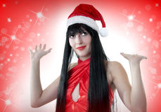 Portrait of beautiful woman in santa hat Stock Images