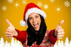 Portrait of beautiful woman in santa hat giving thumbs up Royalty Free Stock Photography