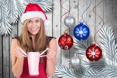 Portrait of beautiful woman in santa hat holding a bag Stock Photography