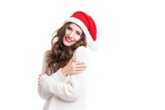 Portrait of a beautiful woman in santa hat with long curly hair. Royalty Free Stock Photo