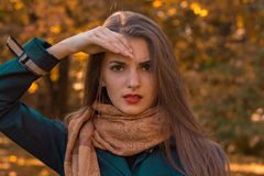 Portrait of beautiful woman in scarf that keeps your hand near hair closeup Royalty Free Stock Photos