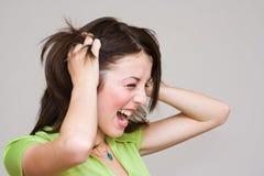 Portrait of a beautiful woman screaming. Close-up portrait of a beautiful woman screaming Stock Photography