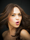 Portrait of a beautiful woman screaming. On black background Royalty Free Stock Images