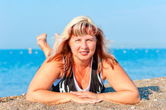 Portrait of a beautiful woman on sea background Stock Images