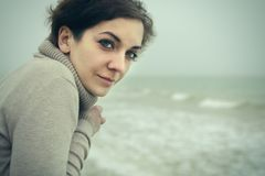 Portrait of a beautiful woman at the sea. Or ocean Royalty Free Stock Photo