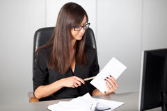 Portrait of a beautiful woman secretary at workplace Royalty Free Stock Images