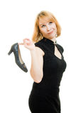 Portrait of a beautiful woman with a shoe Stock Photography