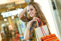 Portrait of a beautiful woman in a shopping center Stock Photos