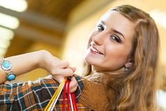 Portrait of a beautiful woman in a shopping center Royalty Free Stock Photos
