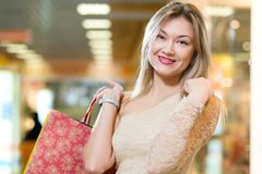 Portrait of a beautiful woman in a shopping center Royalty Free Stock Photography
