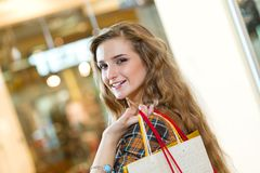 Portrait of a beautiful woman in a shopping center Royalty Free Stock Photo