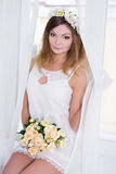 Portrait of beautiful woman in short white bridal dress with flo Royalty Free Stock Photos