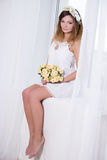 Portrait of beautiful woman in short white dress with flowers si Stock Image