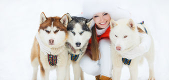 Portrait of a beautiful woman with a Siberian Husky. Royalty Free Stock Photography