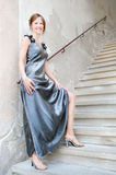 Portrait of a beautiful woman in silver dress Stock Image