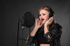 Portrait of a beautiful woman singing into Royalty Free Stock Images