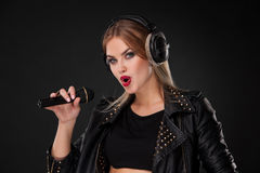 Portrait of a beautiful woman singing into Royalty Free Stock Photography