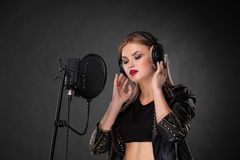 Portrait of a beautiful woman singing into Royalty Free Stock Photo