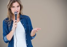 Portrait of beautiful woman singing a song on microphone Royalty Free Stock Image