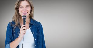 Portrait of beautiful woman singing a song on microphone Stock Photo