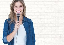 Portrait of beautiful woman singing a song on microphone Stock Images
