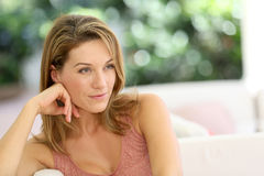 Portrait of a beautiful woman sitting at home Royalty Free Stock Images