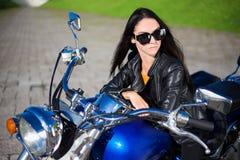 Portrait of beautiful woman sitting on retro motorbike Stock Photos
