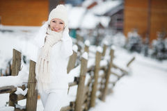 Portrait of a beautiful woman at a ski resort. Royalty Free Stock Photography