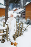 Portrait of a beautiful woman at a ski resort. Royalty Free Stock Images