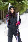 Portrait of beautiful  woman with ski and ski suit in winter mountain Stock Images