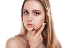 Portrait of a beautiful woman skin care. Young girl cares for the skin royalty free stock image