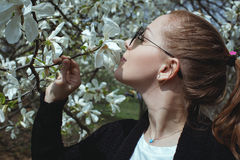 Portrait of beautiful woman smelling a flower royalty free stock photo