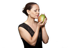 Portrait of beautiful woman smelling mango Royalty Free Stock Image