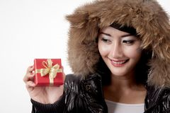 Woman with winter jacket holds gift box Stock Photography